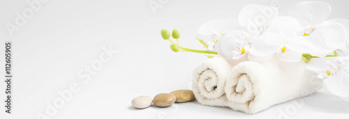 Spa orchid with soft towels and massage stones setting - 112605905