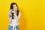 hipster girl with retro vintage camera