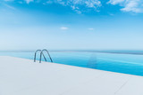 Fototapety Infinity pool on the bright summer day