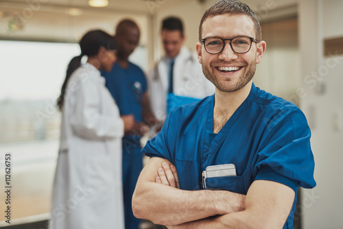 Poster Happy optimistic young hospital surgeon