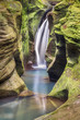 Robinson Falls tumbles into a small sandstone canyon hidden in Ohio's Hocking Hills.