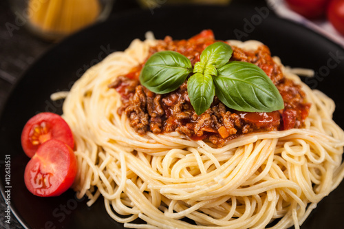 Poszter Spaghetti bolognese on dark background