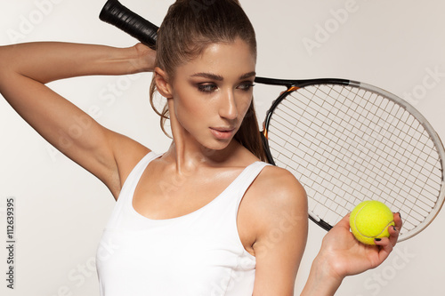 Poster portrait of beautiful fitness sexy woman, tennis player with racket
