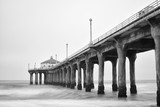 Black and white photo of Manhattan beach pier, California.