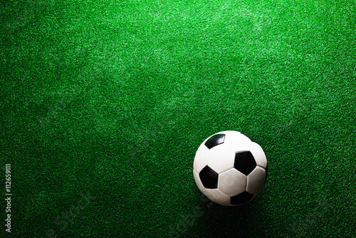 Poster Soccer ball against artificial turf. Studio shot. Copy space.