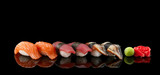 Sushi nigiri set over black background © z10e