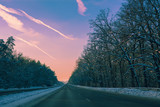 Autobahn in winter at purple sunset