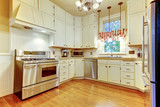Kitchen view interior with hardwood fllor and white cabinets