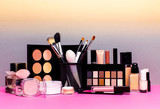 Set of colorful cosmetics on pink table