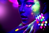 Fototapety Fashion model woman in neon light, portrait of beautiful model girl with fluorescent make-up