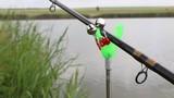 Bell on the fishing rod. Macro shot.