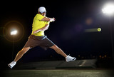 Tennis player at night