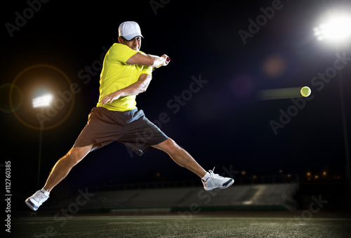 Tennis player at night