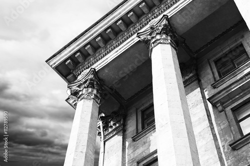 Poster Courthouse facade with columns. Vintage style filter