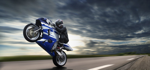 Fast Wheelie On Blue Motorbike © adcdsb