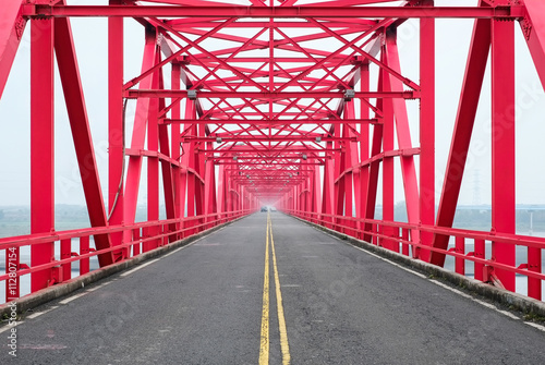 Poster Symmetrical red steel structure construction of bridge and road in Xiluo, Taiwan