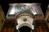 Famous arch at the Praca do Comercio in Lisbon, Portugal with clock at night