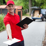 Delivery guy giving a packet