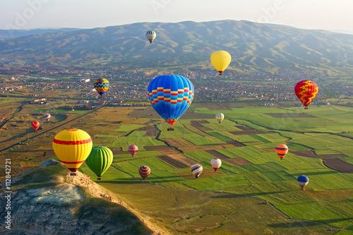 Obraz na Plexi Cappadocia. Colorful hot air balloons flying over the valley at
