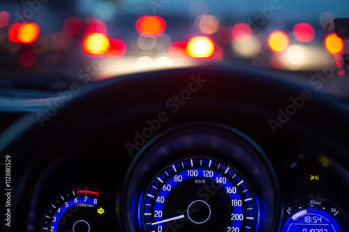 The car console, waiting in a traffic jam at evening Poster