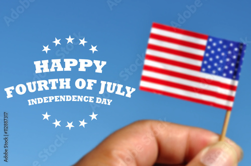 Poster Happy Fourth of July greeting card with american flag in blue sky background