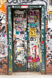 Graffiti covered doorway in New York City - 112889376