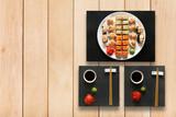 Set of sushi maki and rolls at wood.
