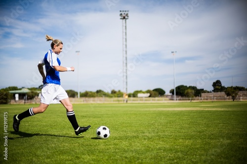 Fotobehang Voetbal Female football player practicing soccer