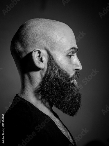 Poszter Black and white portrait of a hipster man in studio.