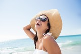 Fototapety  Portrait of smiling woman on the beach
