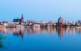Fototapety Night Panorama view to Rostock. River Warnow and City port.