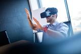 Businessman using virtual reality device