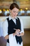 Smiling waitress taking order