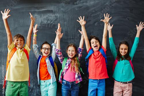 Fotografiet Happy schoolchildren