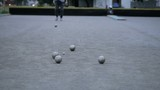People playing bocce ball, outdoors. Canon 5D MK III.