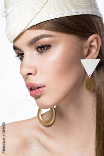 Pretty fresh girl, image of modern Twiggy in fashionable white hat, with unusual eyelashes and accessories.