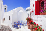 Traditional greek street with flowers in Amorgos island, Greece - 113083167