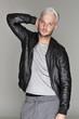 Attractive young guy posing in studio, platinum hair