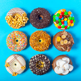 Assorted donuts on a blue background