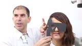 Woman eye cover test at the clinic