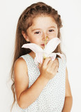 little cute beauty girl isolated on white background holding flower lily in her hair, close up adorable kid