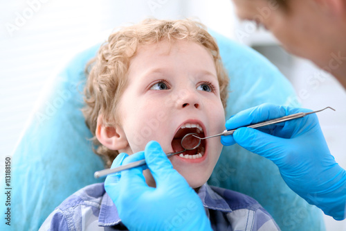 Plagát, Obraz Close up of boy having his teeth examined by a dentist
