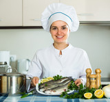 Professional chef cooking mackerel.