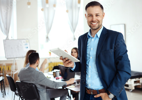 Businessman using his tablet in office