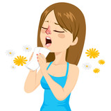 Young woman going to sneeze because of spring allergy making funny face