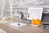 Desktop with laptop and orange