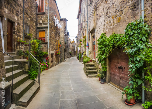 Fototapety, obrazy : Beautiful view of old traditional houses and idyllic alleyway in the historic town of Vitorchiano, Viterbo, Lazio, Italy