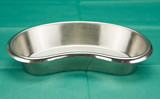 Stainless kidney-shaped bowl on green fabric