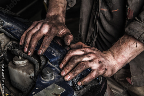 Poster Working man near engine