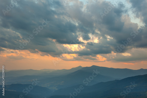 Sundown Sky and Mountains Range Background